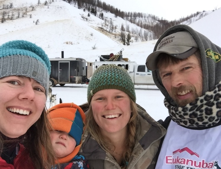 """Meet the team: Darcy, Leo, handler Anna and Gerry. Good spirits despite a very gray day out of Big Piney, """"Where,"""" Darcy adds, """"we have not seen any pine trees."""""""
